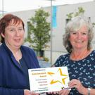 Anne Marie Hammel and Iris McManamin of Kilmuckridge Tidy Towns with their Gold Standard award