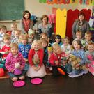 Taking shelter temporarily from their teddy bears picnic for Barnardos at Patricia's Pre-School, Tara Hill
