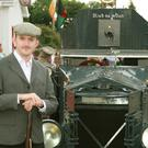 Barry Lacey and John Brennan beside the Sliabh na mBan armoured truck