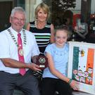 Art competition overall winner Aoibhe McGuigan with Cllr Pip Breen and competition organiser Dorothy Kenny