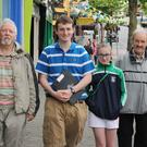 Michael Dwyer (second from left), pictured here giving walking tours during the Byrne Perry Summer School, will once again be giving tours through Gorey as part of Heritage Week