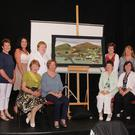 Unveiling of the ICA community tapestry at the recent Gap Arts Festival were, back row: Mary Breen, Boolavogue Textile Studio; Mandy Penney, Geraldine O'Connor, Maureen Cullen, Christine Foran, Boolavogue Textile Studio and Leeann McCartan; front: Benny Hayden, Carmel Coates, Ellen Noctor and Marie Hall