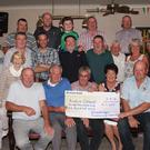 Kilmuckridge Fundraising Committee present €11,600 to Rosslare Lifeboat at the Crosses: Front: Mick Sullivan, Eddie Sinnott, and Bill Donnelly present the cheque to Trish Kavanagh chairperson Rosslare Lifeboat fundraising committee, and lifeboat operations manager David Moloney, watched on by the fundraising committee