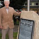 Sean Kelly of Bunclody Historical Society unveiling the plaque