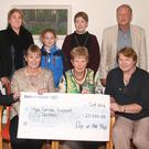 At the presentation of the cheque - front, Christine Meehan; organiser, Eileen Rowe; chairperson, HCSC board of directors, Una Doherty; and vice chairperson, Marge Kehoe. Back- volunteer, Paddy Redmond; organiser, Robin Loughlin with her daughter, Isabella; Linda Meehan; and Jim McCauley, HCSC board of directors