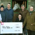 Wicklow Hunt presents €13,000 to Miriam Sheehy to help with medical expenses. From left: Trevor Kelly, Ewina O'Connor, Mark Costello, Miriam Sheehy, hunt master Frank Redmond, and Peggy Murphy