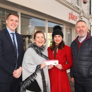 Mervyn Maloney and Marion Barry from competition sponsor South East Radio with Place proprietor Julianna Walters, who won the competition, and Gorey Chamber CEO Dick White