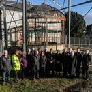 Minister Heather Humphreys, Minister Paul Kehoe, local councillors, council officials and committee members in front of the old conservatory at Castlebridge House.