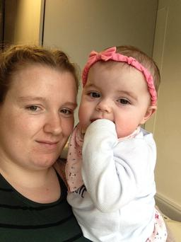 Baby Kyra Hutchins with her mother Amy