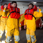 Lee Chin, on the left, in survival gear during the visit to the RNLI College in Poole