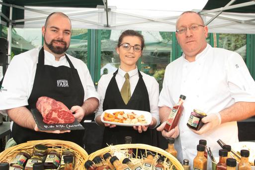 Chef Val Murphy, Lorna Whitty and kitchen and purchasing manager Chris Farrell at the Redmond Farm stand