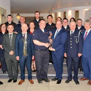 Carlow Civil Defence team receive their prize from Minister Paul Kehoe, who is accompanied by representatives of Wexford County Council, and members of the Dept of Defence and Civil Defence Branch Training