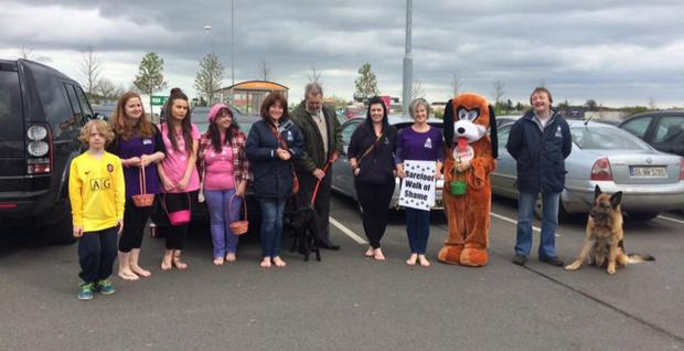 Volunteers taking part in the Barefoot Walk of Shame in aid of the NWSPCA recently