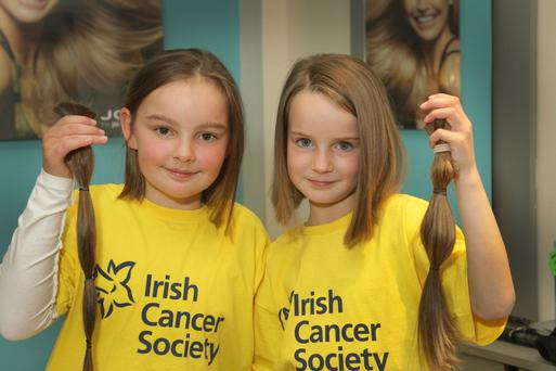 Cousins Jenna Cullen, Ballycanew, and Caoimhe O'Donohoe, Hollyfort, at Halford's Hair Studio after they got their hair cut for the Rapunzel Foundation and the Irish Cancer Society