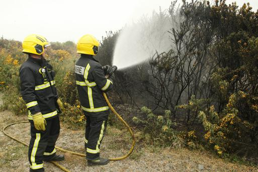 Fire crew put out a gorse fire at lands adjacent to Woodlands Drive