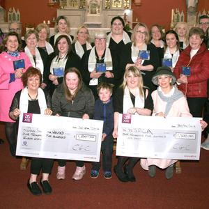 Castlebridge Gospel Choir present two cheques of €1,500 each to Down Syndrome Wexford and the WSPCA, and €500 to Castlebridge Day Care Centre