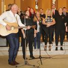 The High Hopes Choir, under the direction of Dr Phil Brennan (left, with guitar) at St Michael's Church, Gorey