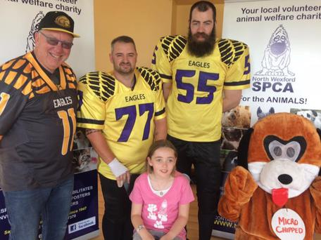 Alex O'Brien pictured with Wexford Eagles coach Kevin Klatt, Wexford Eagles player and Alex's dad Chris O'Brien; Eagles player Rob Farrell and Newton, the NWSPCA mascot