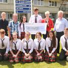 Students at Gorey Community School presented €2,000 to the Asthma Sosiety of Ireland. Front row: Vincent Quinlan, Sinead Casey, Sophie Tuffs, Kayleigh Redmond, Rebecca Gleeson and Michael Duke. Back row: Michael Finn, principal; Michael Martin, father of the late Chris Martin; Ellen O' Connor, Eoin Molloy, Averil Power, chief executive, Asthma Society of Ireland and Frank Duke, deputy principal