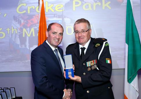Minister of State Paul Kehoe presents Celestine with his medal