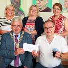 Tina O'Sullivan of Wexford County Council, prizewinners Kerrie Sharpe, Brenda Keogh and Martina Byrne, and librarian Nicola McGrath. Front: Cathaoirleach Cllr Joe Sullivan presenting the overall winning prize to John Moran