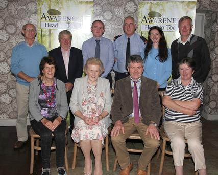 Back: Mervyn Jones, Leslie Dixon, John Kelly, Inspector Pat Cody, Una Sinnott and Michael O'Neill. Front: Emily Burke, Anna May McHugh, who performed the launch, chairman George Graham and Anne Murphy