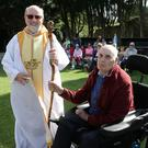 Fr Jim Cogley PP presented local man Brendan Mullins with a specially made staff for him to lead the procession with