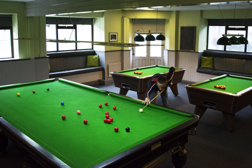 St Patrick's Snooker Club chairman Rob Mulhall is pictured at the snooker table in the revamped club