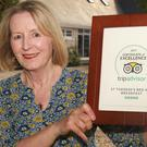 Monica Kenny of St Therese's B&B with her certificate of excellence from Trip Advisor
