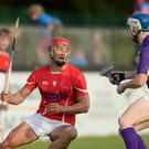 FLASHBACK TO AUGUST 15: Wexford's Lee Chin, representing Davy Russell's Best, in action against Kilkenny's TJ Reid, representing Jim Bolger's Stars, during the sixth annual Hurling for Cancer Research game in aid of the Irish Cancer Society