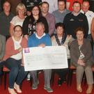 A large crowd gathered in Hammels lounge in Kilmuckridge for the presentation of €14,235 to RNLI Rosslare Harbour, proceeds from boat pull and benefit night. Organiser Eddie Sinnott (centre front) presents the cheque to RNLI Rosslare Harbour fundraising committee chairperson, Trish Kavanagh with, Kerena Ferguson treasurer and Veronica Kehoe, committee, watched on by the many fundraisers and supporters