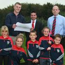 Front row: Zie Poole, Megan Roarke Shannon, Gorey Hockey Club; Dylan Copeland, Izzy Hughes and Isaac Hughes. Back: Podge Cronin, St Joseph's primary school principal; Adrian Copeland, Gorey Hockey Club; Cllr John Hegarty; Declan O'Toole, Creagh College deputy principal; and Martyn Veitch, Gorey Hockey Club chairman