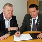 County Council Chairman, John Hegarty (right), and Pat Collins, County Secretary, open the book of condolence to remember victims of the Las Vegas tragedy at County Buildings