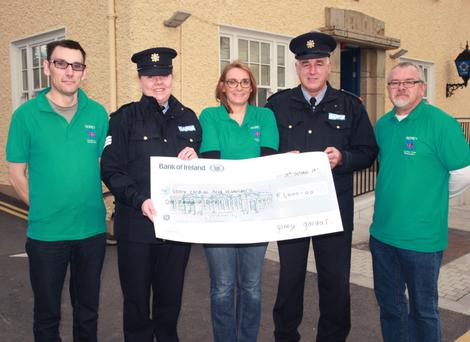 Sgt Evelyn Reddan and Insp Pat Cody present €1,000 to Gorey Cardiac First Responders chairman Stephen Boland, Sinead Mulcahy and Gerard Hegarty.