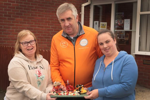 Teresa Barden and Sandra Wickham, Saoirse Training Centre, make a presentation to Cycle Against Suicide ambassador Joe Dixon in appreciation of his work with the organisation.