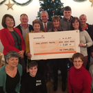 Family members of the late Jimmy O'Keefe with €5,585 cheque for Gorey Hospital