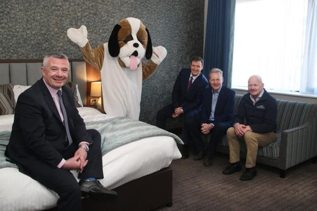 Amber Springs general manager, Eibhear Coyle, hotel mascot, 'Tucker', Minister Michael D'Arcy, proprietors and brothers, Paddy and Tommy Redmond