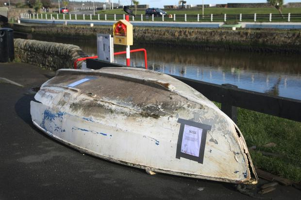 The abandoned boat at Courtown Pier. Wexford County Council has placed a notice on it requesting its removal
