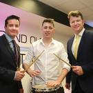 Conor Moore with Wexford County Council chairperson, Cllr John Hegarty and Cllr Malcolm Byrne