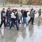Family and friends of Fiona threw 20 roses into the sea at Kilmore Quay to symbolise the 20 years the Bridgetown woman has been missing without trace