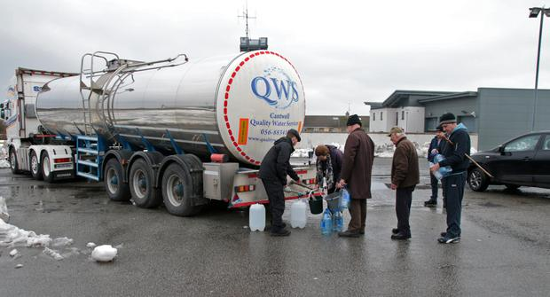Householders queue for water in Clonard