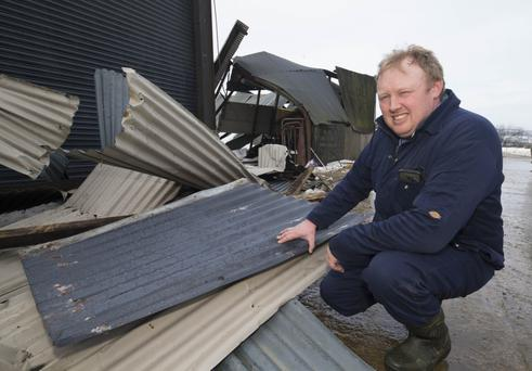 Karol Winters surveys the damage at Winterheights, Taghmon, after sheds collapsed