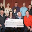 At the cheque presentation (from left) back – Rebecca O'Leary, Cora Mimmagh, James O'Leary, John Sinnott (chairman), Nick Stafford (secretary) and Cliona O'Leary; front – George Murphy (treasurer), Siobhan and Eugene O'Leary (winners) and Patrick Murphy (seller)