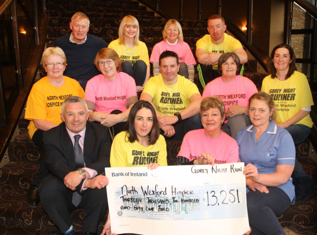 Front: Eibhear Coyle of the Amber Springs and Paula Ryan presenting the cheque to North Wexford Hospice Homecare chairperson Marian Deering and Deirdre Halford of the Beacon Hospital. Middle row: Rosemary Melbourne, Betty Shortle, Cllr John Hegarty, Cecily Jones and Mary Furney. Back: Dr Michael O'Doherty, Ciara Spellman, Margaret O'Doherty and Aidan Hegarty