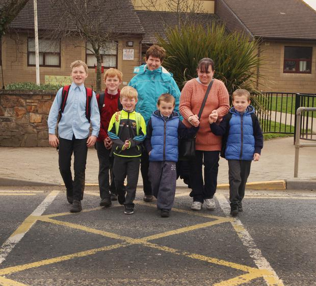 Breda Fitzpatrick with brothers, Noah, Leo and Billy James pictured with, Jane McDonald and her sons, Christopher and Aidan Quigley outside Camolin NS yesterday (Monday)