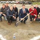 Minister Michael D'Arcy turning the sod of the new community complex along with Conor Owley, club chairman Jim O'Connor, Patsy Fortune, Tom Banville, Donal Duffy, Brian McDonald, Gary Marshall, John Dempsey and Jim Higgins