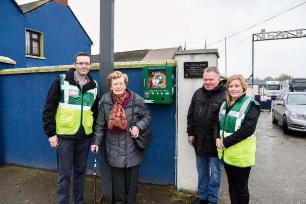 Enda Furlong from Ferns CFR, Jenny Somers of Somers Commercials and Ken Hawthorne and Mary Gethings from Ferns CFR with the new defibrillator, which is located on Main Street in Camolin