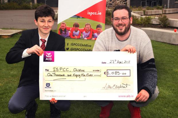 Transition year student Ben Handrick from Creagh College presents a cheque for €1,085 to Ray Traynor from ISPCC Childline