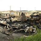 The burnt-out caravan at Parklands Mobile Homes
