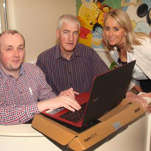 Gorey Chamber CEO Diarmuid Devereux and Chamber vice president Sinead O' Sullivan present two laptops to Dr Joe Gallagher and Dr. Peter Harrington for Malawi hospitals